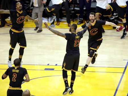 Cleveland Cavaliers forward LeBron James (23) celebrates with Cleveland Cavaliers guard J.R. Smith (5) and Cleveland Cavaliers forward Kevin Love (0) after beating the Golden State Warriors in Game 7. Kelly L Cox USA TODAY Sports