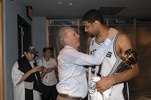 Coach Pop & Timmy - Andrew D. Bernstein/NBAE/Getty Images